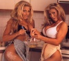 Girl with muscle - Trish Stratus (l) Stacey Lynn (r)
