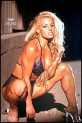 Girl with muscle - Trish Stratus